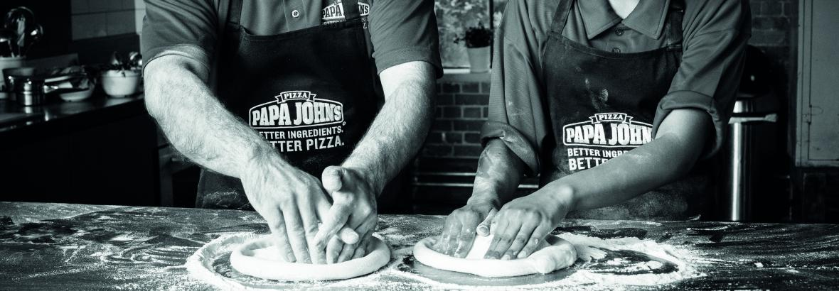 Crew making Pizza